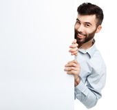 A young bearded man showing blank signboard, isolated over white Stock Images