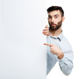 A young bearded man showing blank signboard, isolated over white Stock Photography