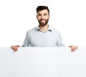 A young bearded man showing blank signboard, isolated over white Stock Image
