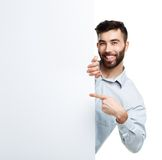 A young bearded man showing blank signboard, isolated over white Royalty Free Stock Images