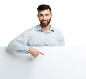 A young bearded man showing blank signboard, isolated over white Royalty Free Stock Photography
