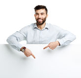 A young bearded man showing blank signboard, isolated over white Royalty Free Stock Image