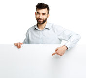 A young bearded man showing blank signboard, isolated over white Royalty Free Stock Photos