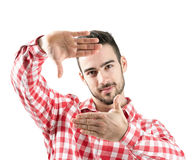 Young bearded man showing finger frame isolated Royalty Free Stock Photography