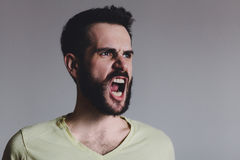 Young bearded man showing negative emotion Stock Photography