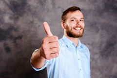 Young bearded man showing thumb up Royalty Free Stock Photography