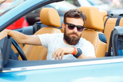 Young bearded man sitting in a convertible Royalty Free Stock Photography