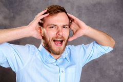 Young bearded man is stressed Stock Photo