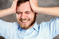 Young bearded man is stressed Stock Image