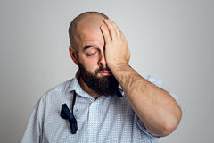Young bearded man is tired after party Royalty Free Stock Photography