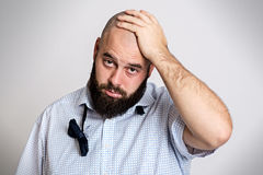 Young bearded man is tired after party Stock Photo