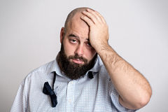 Young bearded man is tired after party Royalty Free Stock Image