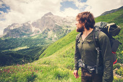 Young Bearded Man Traveler with backpack mountaineering Royalty Free Stock Photos