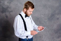 Young bearded man using tablet PC Royalty Free Stock Photo