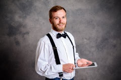 Young bearded man using tablet PC Stock Photos