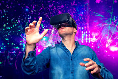 Young bearded man wearing virtual reality glasses in modern interior design coworking studio. Smartphone using with VR goggles he. Adset. Horizontal,flares royalty free stock images