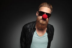 Young bearded man wears a red nose Stock Photos