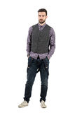 Young bearded modern hipster with hands in pockets Royalty Free Stock Photo