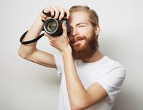 Young bearded  photographer Royalty Free Stock Photo