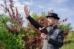 Young bearded priest holding book Stock Image