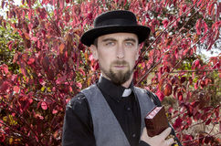 Young bearded priest Stock Photo