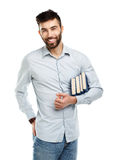 Young bearded smiling man with books in hand on white Royalty Free Stock Photos
