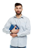Young bearded smiling man with books in hand on white Stock Images