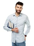Young bearded smiling man with books in hand on white Stock Photos