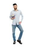 Young bearded smiling man with books in hands on white Royalty Free Stock Image