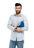 Young bearded smiling man with books in hands on white Royalty Free Stock Photos