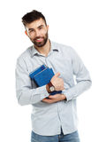 Young bearded smiling man with books in hands on white Stock Photos