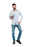 Young bearded smiling man with books in hands on white Royalty Free Stock Photo