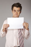 Young beaten up businessman with bad sales results document Stock Images