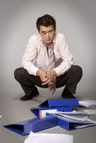 Young beaten up caucasian businessman - failure concept Royalty Free Stock Photo