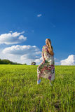 Young beatiful girl in green field Royalty Free Stock Photos