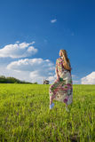 Young beatiful girl in green field Stock Images