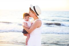 Young beatiful woman with baby on the beach Royalty Free Stock Photo