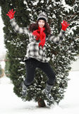 Young beauitiful woman outdoor in winter jumping royalty free stock image
