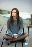 Young beautful brunette woman with her smartphone outdoors Royalty Free Stock Images