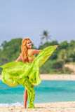 Young beautful woman on tropical tree background, Stock Photography