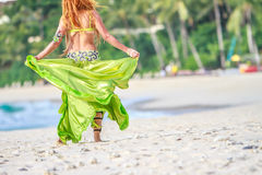 Young beautful woman on tropical tree background, Royalty Free Stock Photo