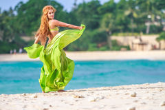 Young beautful woman on tropical tree background, Royalty Free Stock Photos