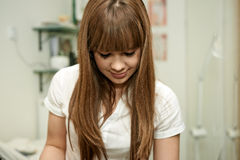 Young beautician woman in health salon Stock Image