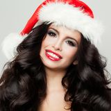 Young Beautifu Brunette Girl in Christmas Hat Smiling. Closeup New Year Portrait Royalty Free Stock Image