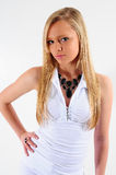 Young and beautiful. Young female fashion model wearing a white top and jewellery Royalty Free Stock Image