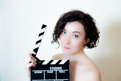 Young beautiful actress with clapper board Royalty Free Stock Images