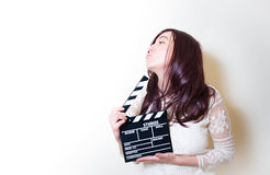 Young beautiful actress with clapper board Stock Image