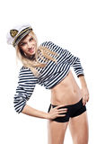 Young Beautiful Adorable Woman in sea peak-cap and stripped vest Royalty Free Stock Photography