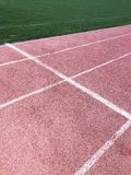 Red running track in the stadium. texture for your design stock images