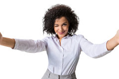 Young beautiful African American woman makes self against the white background in studio Stock Images